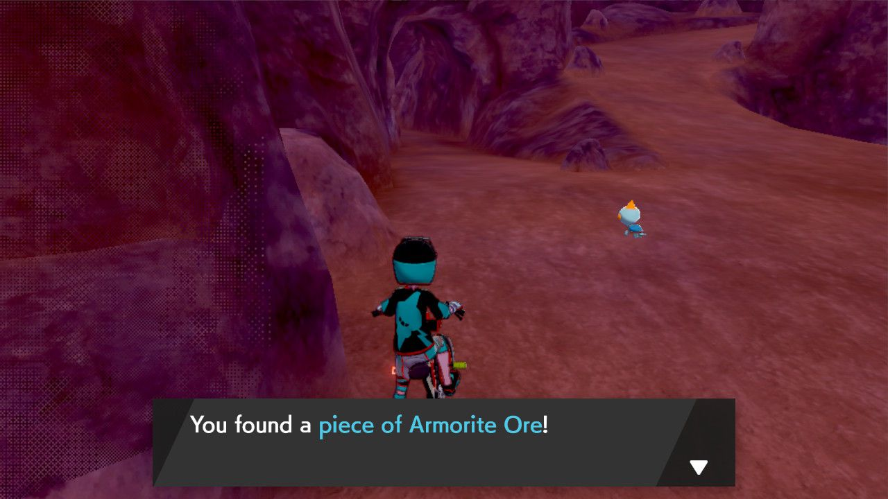 Image showing looting Armorite Ore from a sparkly loot spot in Isle of Armor for Pokemon Sword and Pokemon Shield.