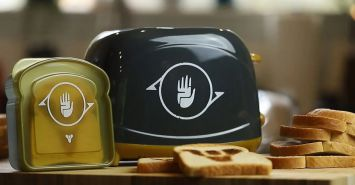 Destiny toaster with piles of toast and sanwhich holder.